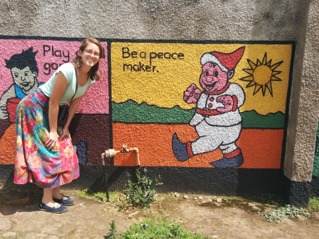 Stopping to pose by some cute art while exploring the town