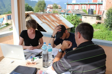 Photograph of EMI team working at the hotel upon returning to Palung
