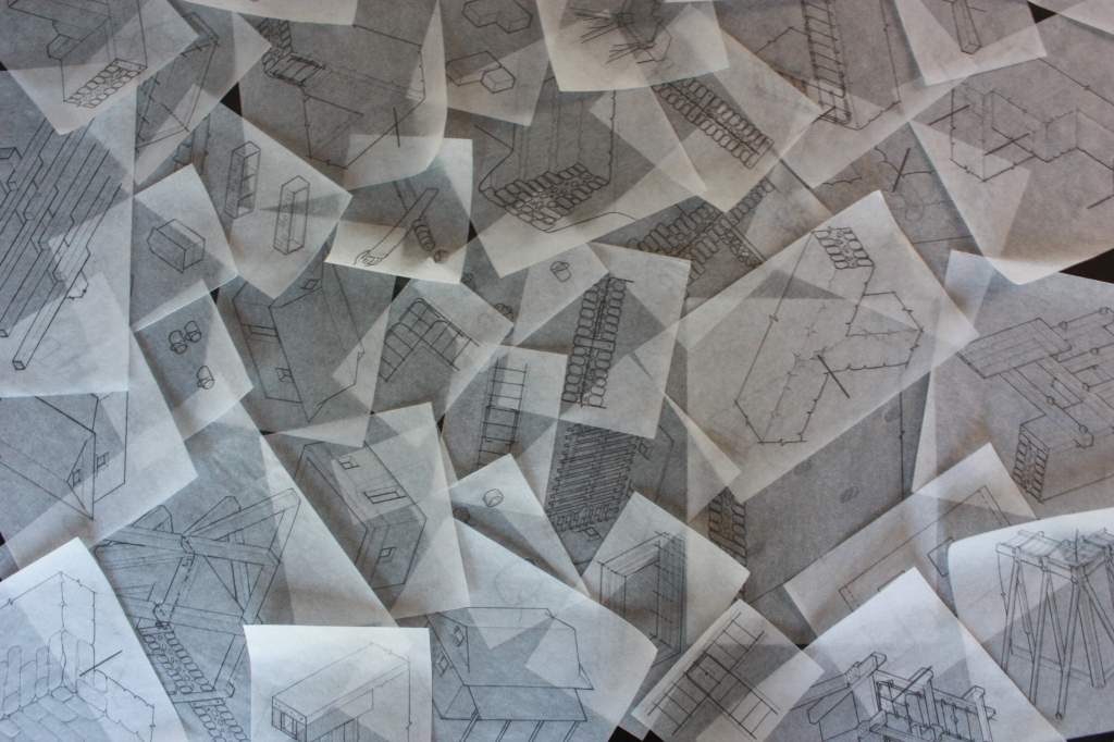 Photograph of table covered in drawings